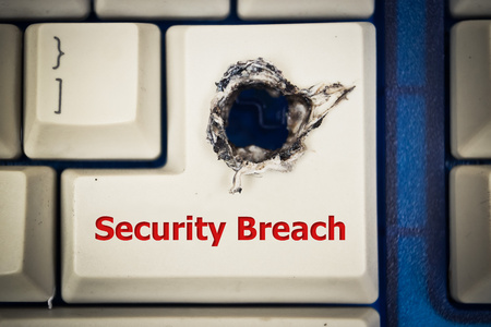 penetrate: Computer enter keyboard with a hole  Computer security breach Stock Photo