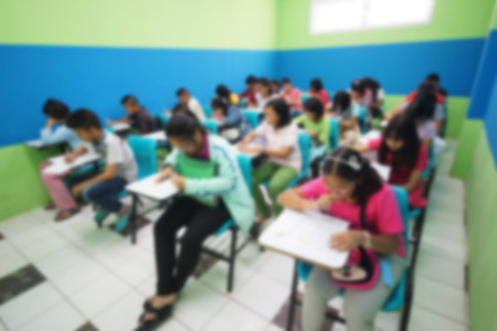 forced: Abstract blurred of young students studying on weekends in a small class of a tutorial school Stock Photo
