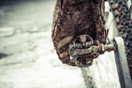 mountain bike clipless shoes with mud and dirt stuck in the pedal
