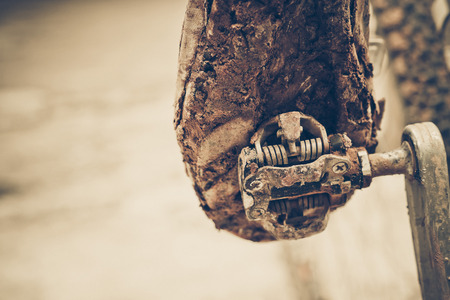 bicycle wheel: mountain bike clipless shoes with mud and dirt stuck in the pedal