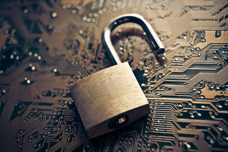 security breach: open security lock on computer circuit board - computer security concept