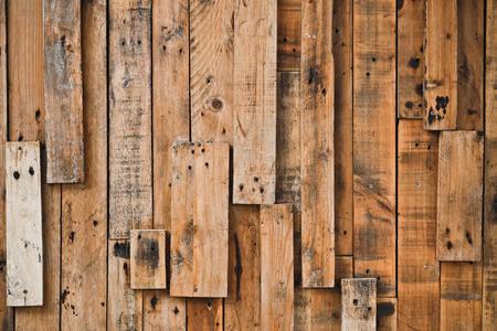 parquet floor layer: old and dirty wood planks with nail holes arranged as a wall background
