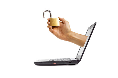 coming: Hand holding a security lock coming out from a computer screen computer security concept