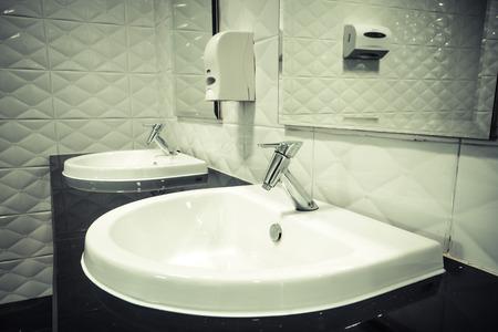 washbasin: washbasin in a toilet Stock Photo