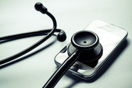 stethoscope on smartphone - checking security on smartphone concept Foto de archivo