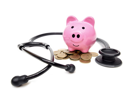 health management: a stethoscope with pink piggy bank