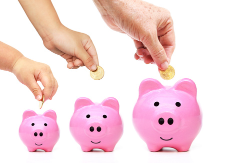 Family saving money in the pink piggy banks concept