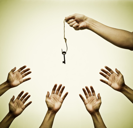 hung: Many hands trying to get a key hung on a fish hook - the victim of success