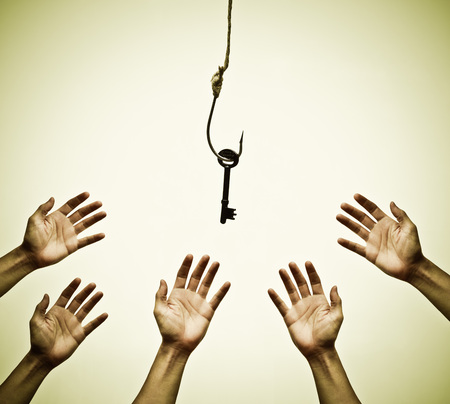 Many hands trying to get a key hung on a fish hook - the victim of success