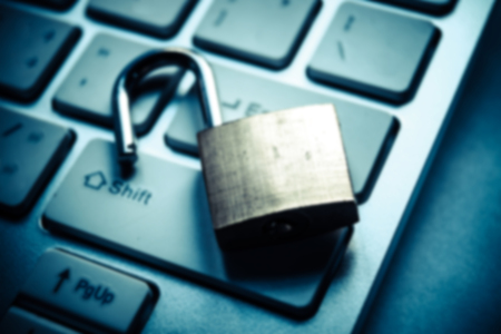 Abstract blurred background of a security lock on computer keyboard - computer security breach concept Stock Photo