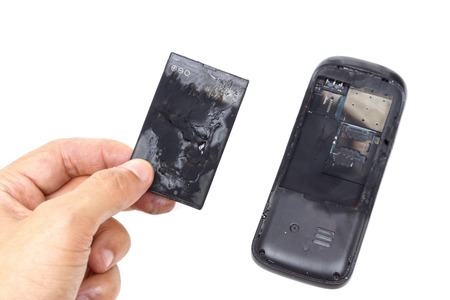 overuse: mobile phone battery explode and burn due to overheat Stock Photo