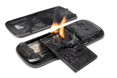 mobile phone battery burn due to overheat Stock Photo