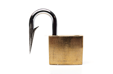 infiltration: a fish hook pretending to be a security lock - computer security concept - spyware pretending to be a security program trying to infiltrate the system Stock Photo