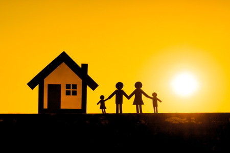 staying in shape: Paper cut of family and a house with sunset background  Family Life Insurance  Protecting family  Family concepts