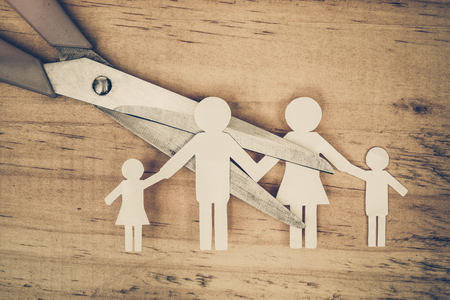 Scissors cutting paper cut of family / Broken family concept / divorce