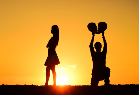 sulk: A man and a woman holding a broken heart
