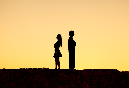 difficulties: Silhouette of a angry woman and man on each other  Relationship difficulties  Couple break up Stock Photo