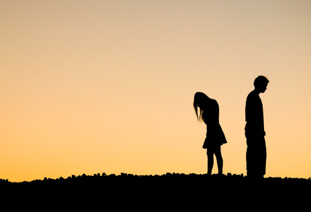 difficulties: Silhouette of a angry woman and man on each other.Relationship difficulties Stock Photo