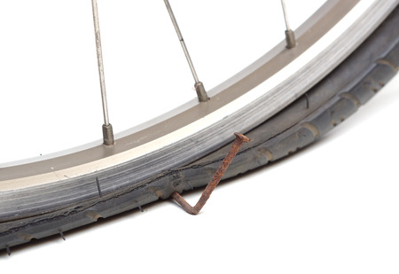 penetrate: bicycle tire got puncture due to old rusty nail