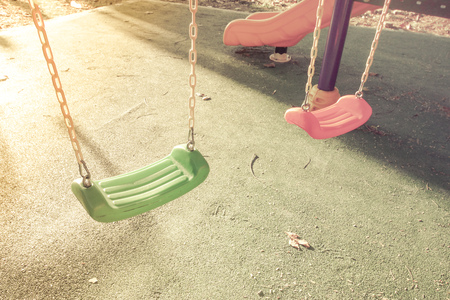 totter: chain swings hanging in garden with morning light Stock Photo