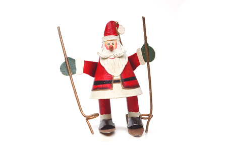 classic santa: old classic Santa Claus tin toy playing ski isolated Stock Photo