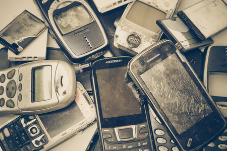 discarded: old mobile phones and battery  Electronic waste concept Stock Photo
