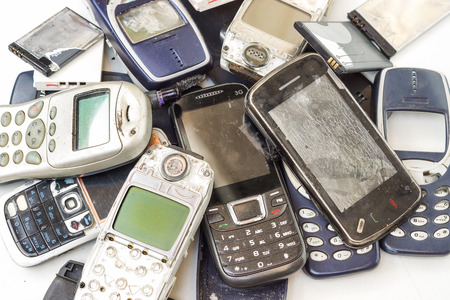 old mobile phones and battery  Electronic waste concept Stok Fotoğraf