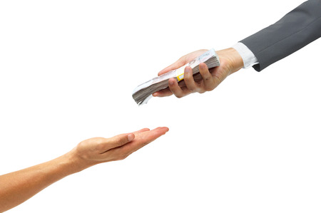 cash cycle: hand of a businessman giving a pile of banknote to the other hand  Loan concept  Politician buying vote Stock Photo