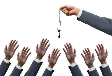 insincere: hand of a businessman holding a fish hook with a key over many hands of businessmen - opportunist concept