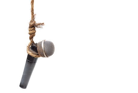 oppressed: Broken microphone hung on a rope - Threatening press freedom concept