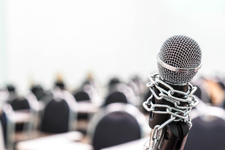 oppressed: A chained microphone - Freedom of the press is oppressed.