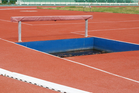 hurdle: Running track with hurdle and puddle