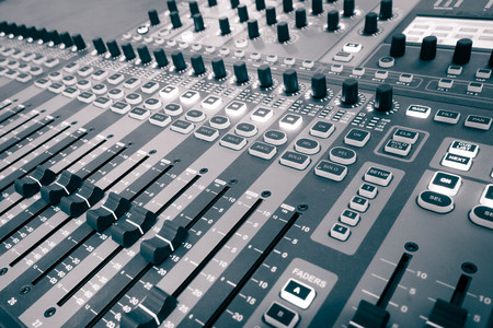 decibel: audio mixing console with faders and adjusting knobs Stock Photo