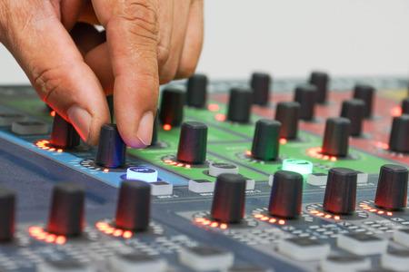 adjusting: hands adjusting audio controller