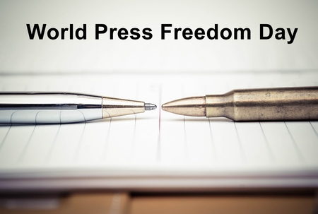 freedom: Pen vs. Bullet  Freedom of the press is at risk concept  World press freedom day concept