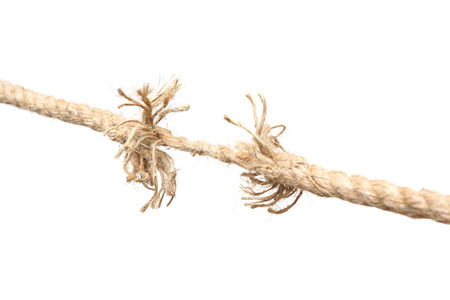 nearly: Rope nearly torn apart isolated - risk concept Stock Photo