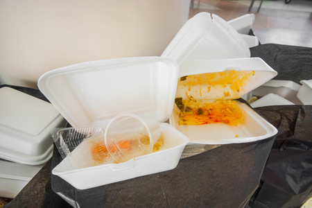unfriendly: Foam food containers in the bin - Takeaway food and environmental problems concept