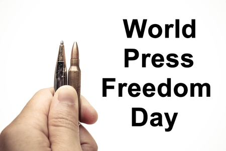 oppress: Pen vs. Bullet  Freedom of the press is at risk concept  World press freedom day concept