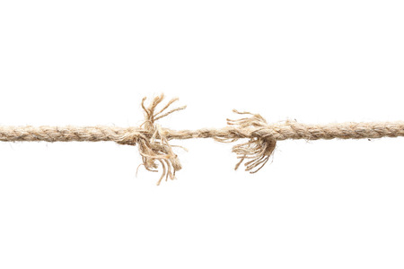 apart: Rope nearly torn apart isolated - risk concept Stock Photo