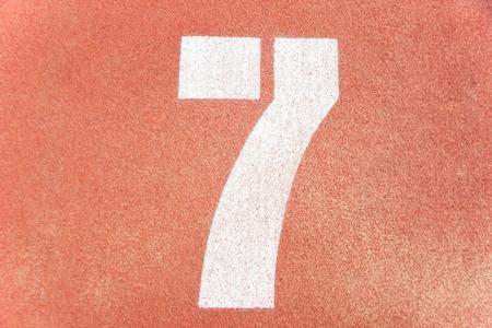 number seven: Number seven on running race lane
