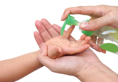 Applying cleaning gel on baby's hand
