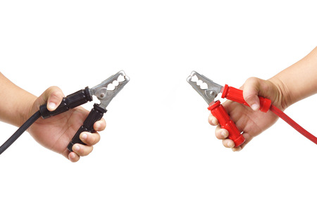 hand holding jumper cables isolated on white background