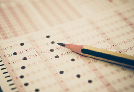 answer: Multiple choice answer sheet with a pencil