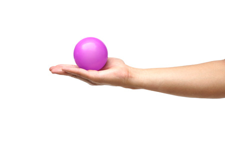 young add: hand holding a purple ball isolated