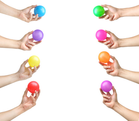 young add: hands holding colorful plastic balls isolated Stock Photo