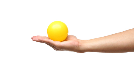 young add: hand holding a yellow ball isolated