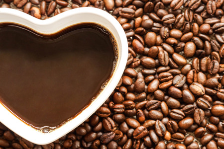 Coffee. A cup of coffee with a heart shape surrounded by coffee beans. Love drinking coffee concept Stock Photo