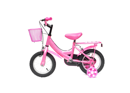 pink bike: A bicycle for kid in pink color. A pink bike with training wheels on isolated background Stock Photo