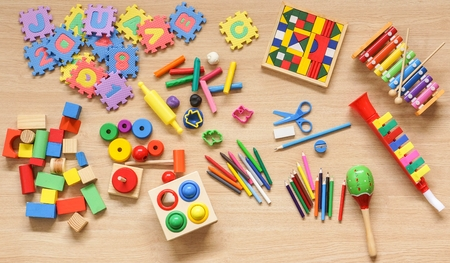 Toys and stationery for kids to play and learn  Back to school concept Stock Photo