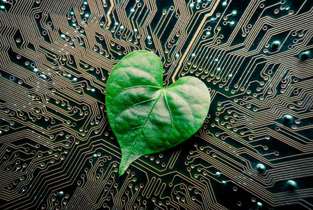 green computing: A green leaf with a heart shape on a computer circuit board  green it  green computing  csr  it ethics